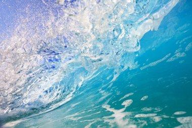 Inside the ocean wave, blue water in motion