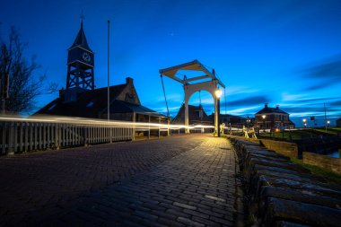 Night view on the authentic old harbor town of Hindelopen in the province of Friesland in the Netherlands