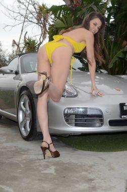 Alicia Arden in Bikini Shoot for her Porsche Boxster