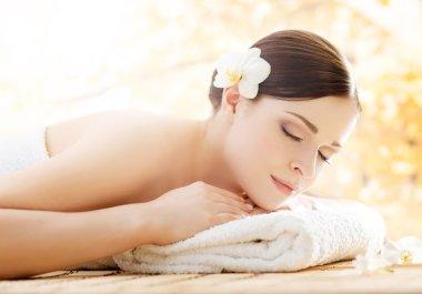 Beautiful woman relaxing in spa salon