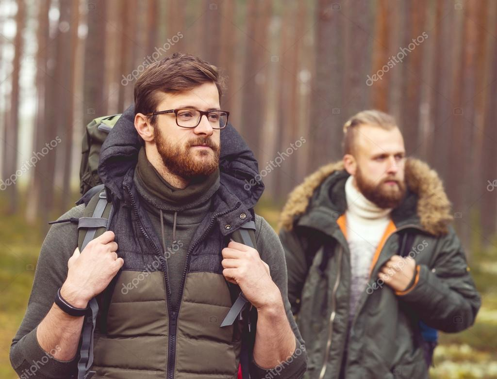Young men hiking in forest