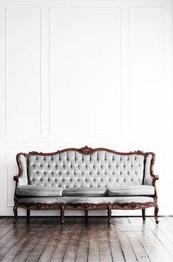 Ancient sofa in retro interior