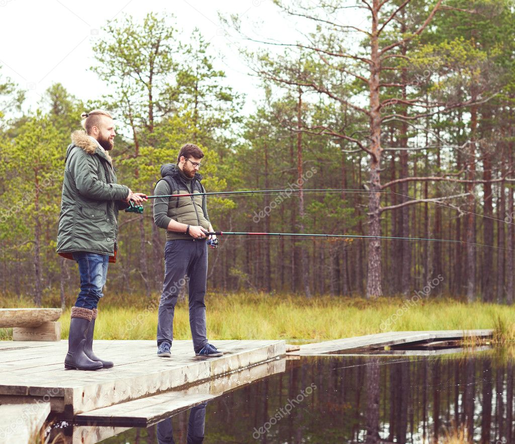 Young men fishing with spinning rods