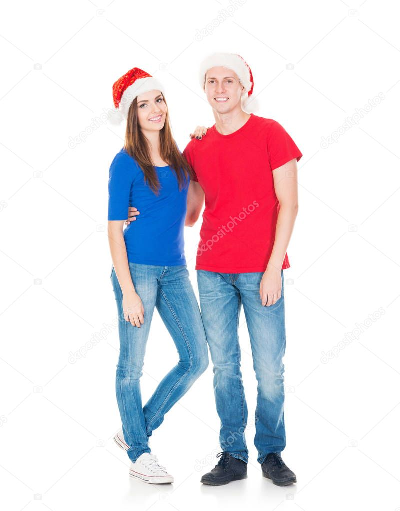happy couple in red Christmas hats