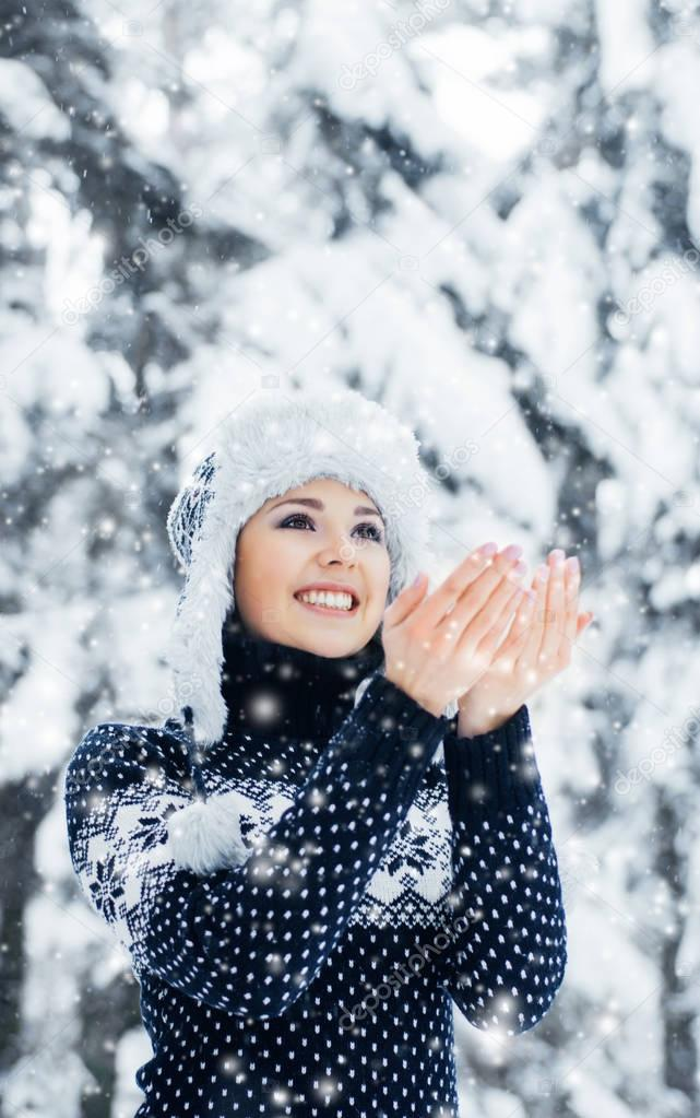 young woman in beautiful winter forest