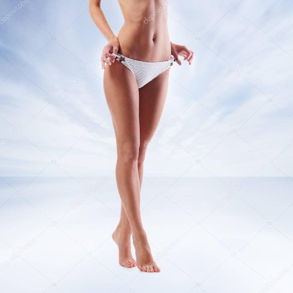 Slender and fit legs of young woman