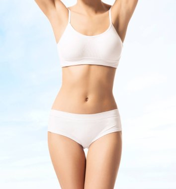 Young and fit woman in white sporty clothes