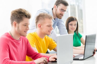 Group of students at informatics and programming lesson