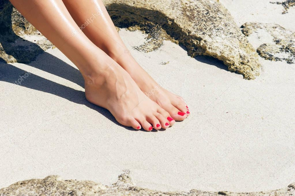 feet with red pedicure