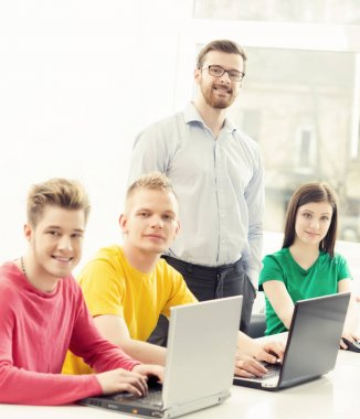Students and teacher at programming lesson