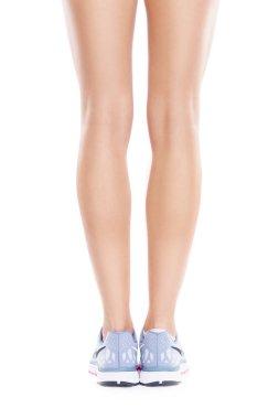 female legs wearing running shoes