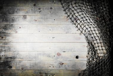 Fishing nets on wooden planks