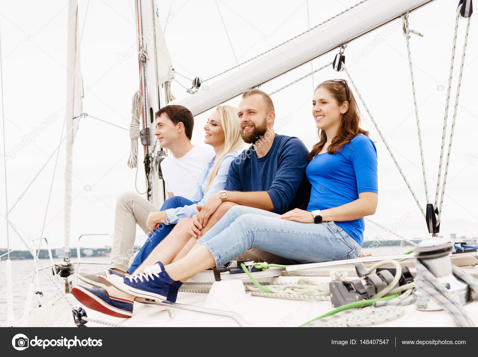 8c686565069 Happy friends sitting together on a deck of a yacht — Stock Photo ...