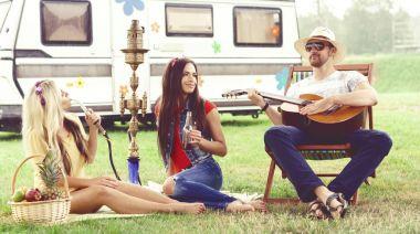 Guy and young women smoking hookah