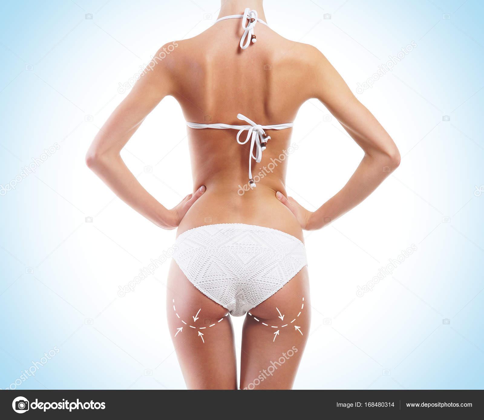 19f1f21cd Ajuste e desportiva mulher em traje de banho biquíni branco com setas no  seu plano de fundo do corpo