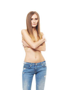 beautiful young woman in stylish jeans posing topless isolated on white background