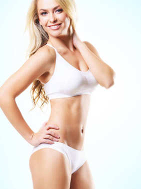 fit and sporty blonde woman in white lingerie over light background. Sport, fitness, diet, weight loss and healthcare concept