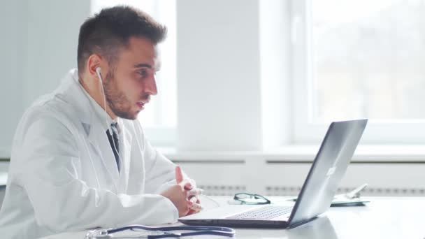 Professional medical doctor working in hospital office using computer technology. Medicine and healthcare concept.