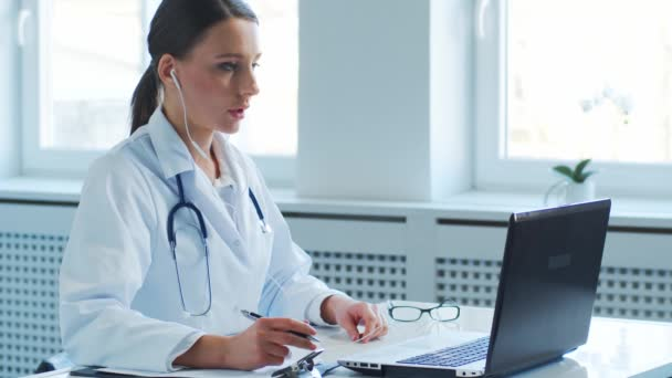 Professional medical doctors working in hospital office making conference call. Medicine, healthcare and online consultation concept.