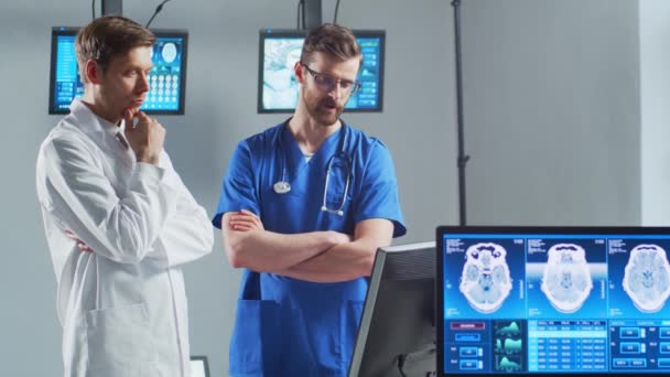 Professional medical doctors working in hospital office using computer technology. Medicine, neurosurgery and healthcare concept.