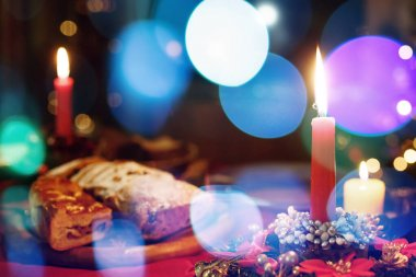 Traditional Christmas festive dinner with candles, defocused image