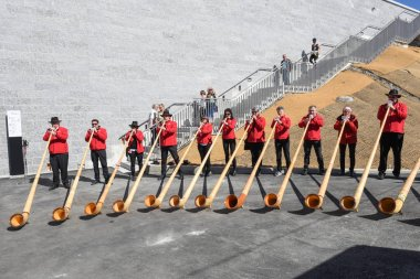 People playing the alphorn at Mount Generoso on Switzerland