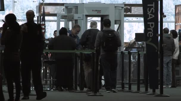 People at TSA security check in with agent before their travels.