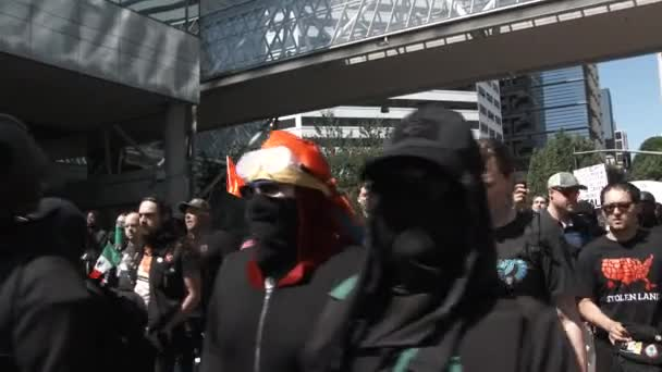 Protesters and members of the Antifa fill city streets, marching and chanting against fascism.