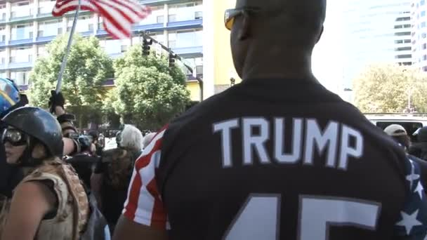 Man shows off his USA Trump jersey at Rally downtown.