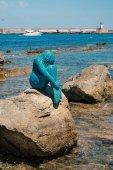 Ile Rousse, Corse - cca červenec 2017: Mořská panna socha na skalách