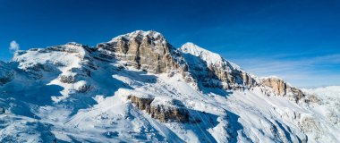Panoramic mountain snow landscape. Tofana cable car. Dolomites, Italy.