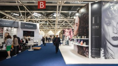 BOLOGNA, ITALY - MARCH 16, 2018: People visit Cosmoprof exhibition, the largest beauty and cosmetic sector trade show in Italy.