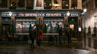 LONDON, UK - CIRCA JANUARY, 2018: The traditional exterior of the Sherlock Holmes pub on Northumberland Street in Westminster at night.