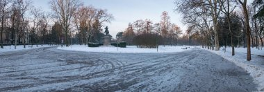 Regina Margherita park covered with snow in winter time panoramic view. Bologna, Italy.