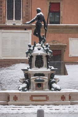 Neptune fountain covered with snow. Bologna, Italy.