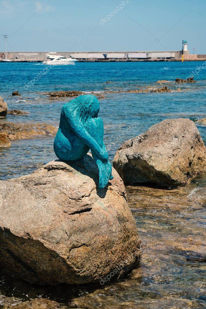 ILE ROUSSE, CORSE - CIRCA JULY, 2017: Mermaid sculpture on the rocks.