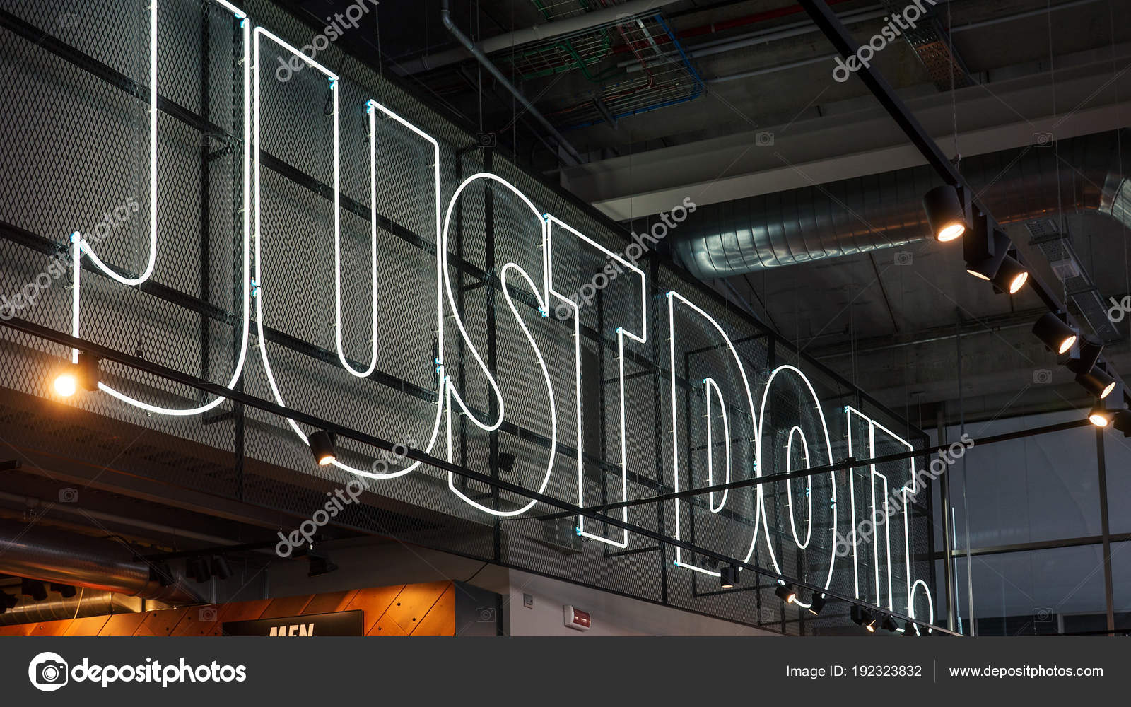 the latest 116cd 5cb0a MILAN, ITALY - SEPTEMBER 27, 2016  JUST DO IT inside Nike store. Nike is  one of the world s largest suppliers of athletic shoes and apparel.