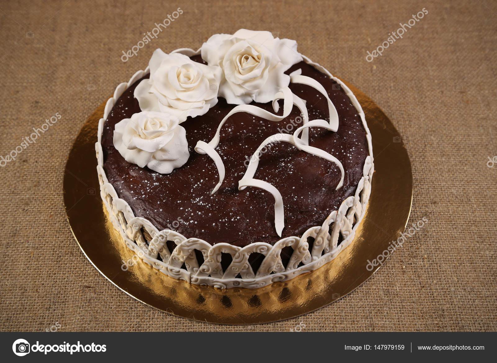 Chocolate cake decorated white fondant flowers stock photo volke chocolate cake decorated white fondant flowers stock photo mightylinksfo