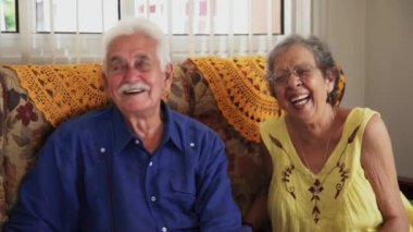 Group Of Happy Friends Laughing And Talking In Retirement Home