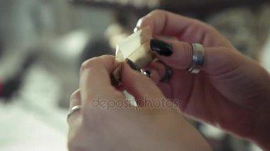 Woman Preparing Hashish Joint Rolling Marijuana Cigarette For Smoking