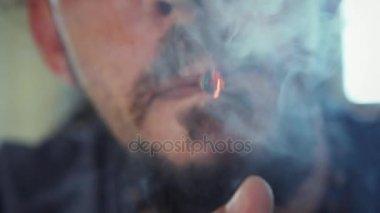 Hispanic Man Smoking Hashish Joint Marijuana Cigarette For Fun