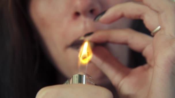 Latina Woman With Lighter Smoking Hashish Joint Marijuana Cigarette