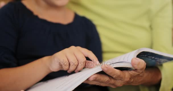 Girl Reading Book To Old Woman Family Relationship And Leisure