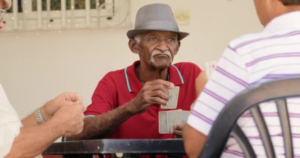 3 Old Friends Playing Cards Game Senior Men Having Fun