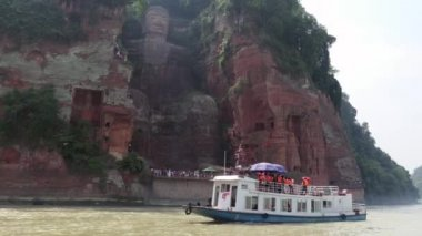 Boat And People Near The Leshan Giant Buddha In China