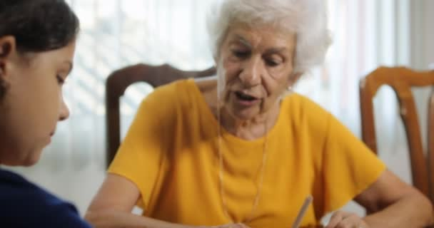 Little Girl Doing School Homework With Old Woman