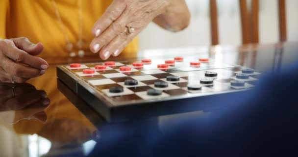 Board Game With Elderly Woman And Little Girl Playing