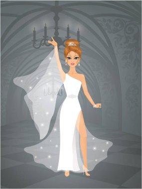 Cute bride in a castle. She is wearing an elegant wedding dress.