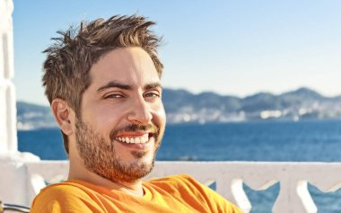 Happy young man on vacation beside the sea in Spain