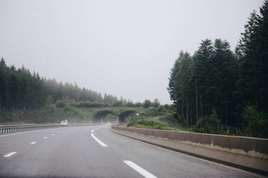 Cars on highway in rainy day